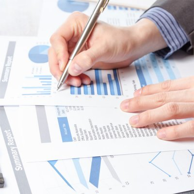 stock-photo-85484579-business-man-analyzing-graph-and-chart-document-report.jpg